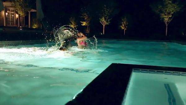 2 Girls Flip Their Hair And Make A Big Splash In A Pool At Night Slow Motion Dolly Shot