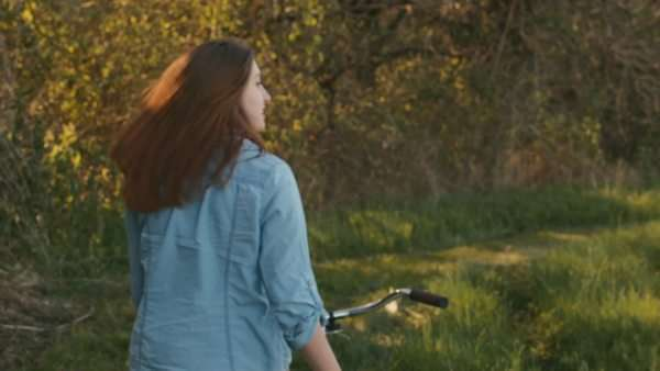 Young Woman Enjoys The Scenery As She Walks Alone Down Country Path With Her Bicycle Royalty-free stock video