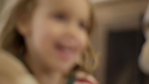 Excited little boy grabs his new teddy bear, beneath Christmas stockings, and runs happily toward camera Royalty-free stock video