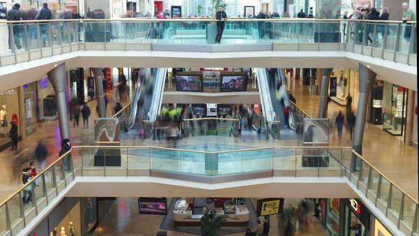 Timelapse sequence showing interior of busy shopping mall with customers. Royalty-free stock video