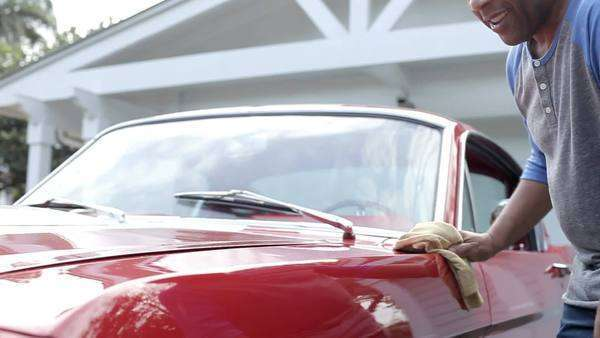 Retired senior man cleaning restored car in slow motion Royalty-free stock video