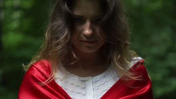 dae057ad4df Mysterious woman in red cape in forest, super slow motion stock footage