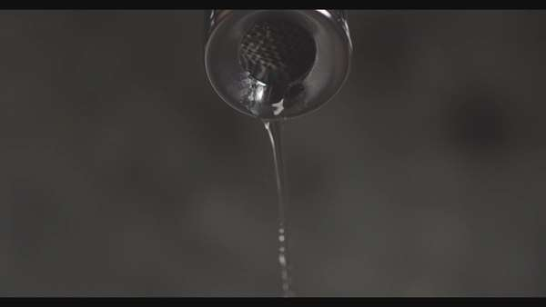 Close up shot of water dripping from a tap Royalty-free stock video