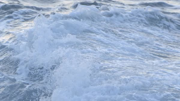 Close-up shot of a wave breaking on a rock Royalty-free stock video