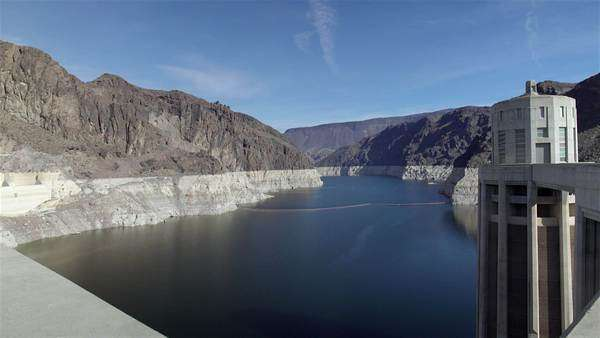 Hoover Dam is a concrete arch-gravity dam in the Black Canyon of the  Colorado River stock footage