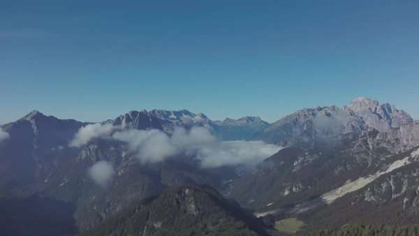 Flying over the mountain ridge opens panoramic view to mountains around it, aerial shot Royalty-free stock video