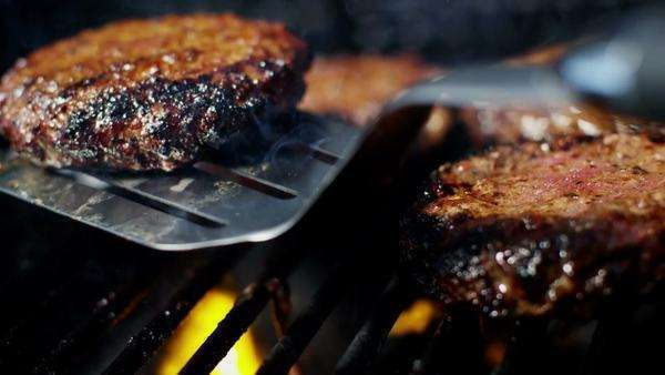 Close up shot of hamburgers grilling on barbecue Royalty-free stock video