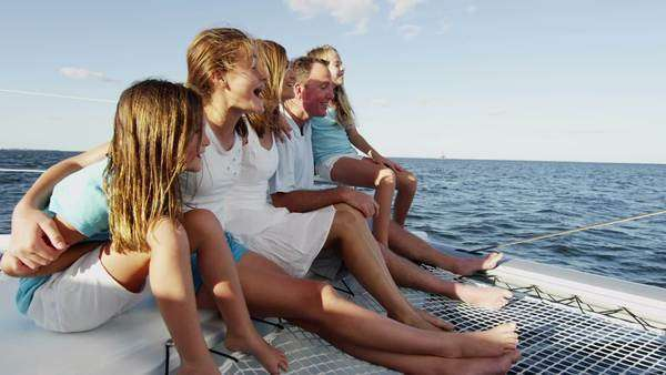 Family of five enjoying time together on a yacht Royalty-free stock video