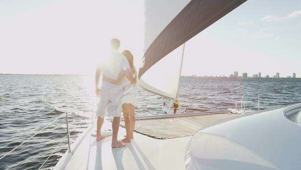 Husband and wife couple enjoying time together on a yacht Royalty-free stock video