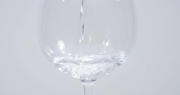 Water Pouring Into Wine Glass Stock Footage