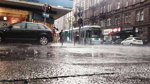 Rain in city with cars and people walking in the background Royalty-free stock video