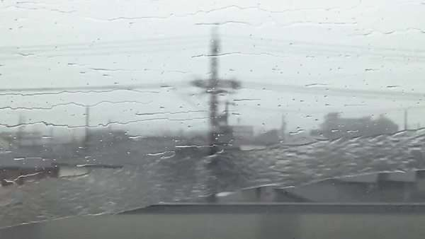Slow motion of rain trickling down the window of a train Royalty-free stock video