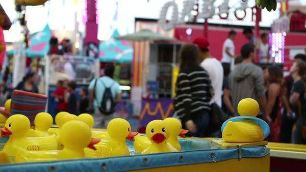 Locked off shot of a fairground capturing the Duck Pond Carnival Game Royalty-free stock video