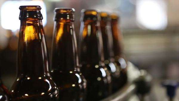 Static shot of automatically conveyed beer bottles inside a brewery Royalty-free stock video