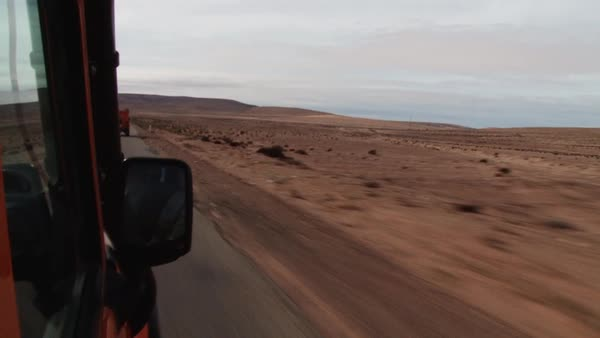 POV shot of traveling on a road in the desert Rights-managed stock video