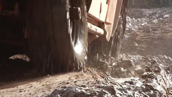 Medium shot of a truck driving on a dirt road Rights-managed stock video