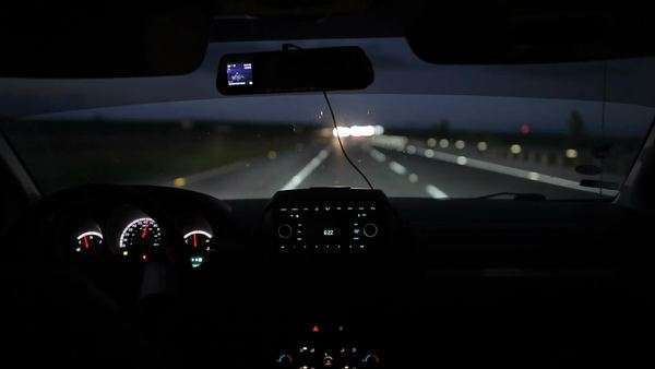Driving A Car At Night Or Early Morning View From Inside With Luminous Dashboard And Blurry Lights Of Oncoming Vehicles Stock Video Footage Dissolve