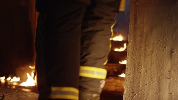 Two firefighters go up burning stairs Royalty-free stock video