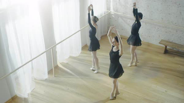 Three young and  ballerinas practicing dancing in sync Royalty-free stock video