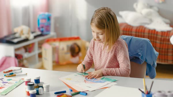 Talented little girl in her room draws with crayons. Royalty-free stock video