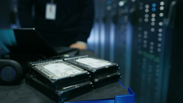 In data center IT technician pushes crash cart with various hardware and laptop on it. Royalty-free stock video