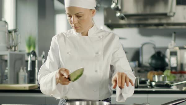 Young Female Chef in a Restaurant Prepares Complicated Dishes. Kitchen Looks Modern. Royalty-free stock video