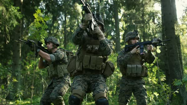 Three Fully Equipped Soldiers Wearing Camouflage Uniform Attacking Enemy They Re In Shooting Ready Stance Aiming Rifles Military Operation In