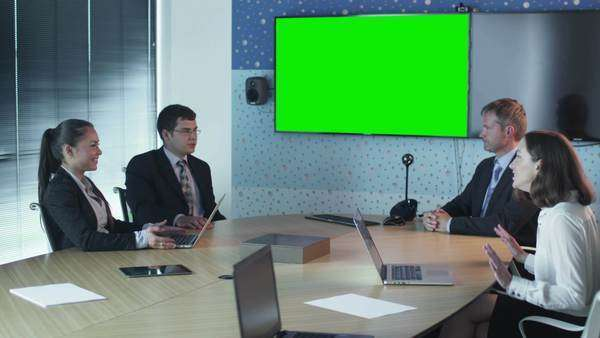 Team of office workers have conversation in conference room with green screen display. Royalty-free stock video