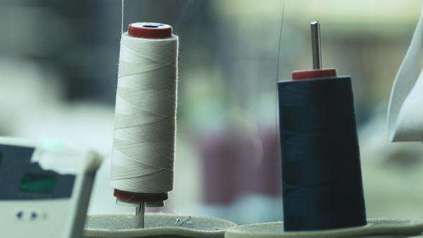 Close-up shot of cotton threads for sewing machine in action. Royalty-free stock video