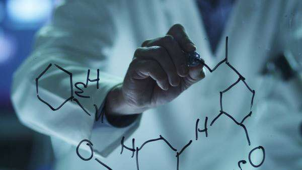 Scientist is drawing organic chemical formulas on glass Royalty-free stock video