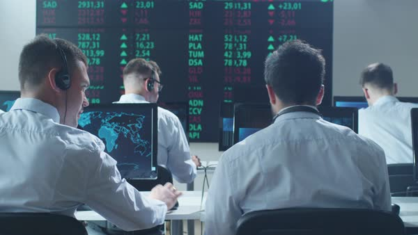 Group of stockbrockers actively working at stock exchange Royalty-free stock video