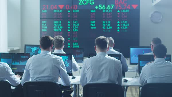 Group of stockbrockers celebrating success at stock exchange Royalty-free stock video