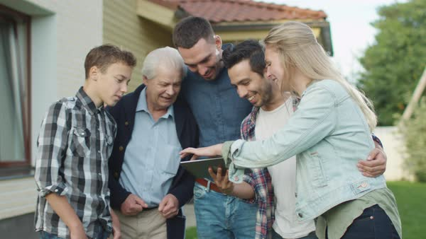 People of Various Ages Use Tablet During Family Gathering Royalty-free stock video