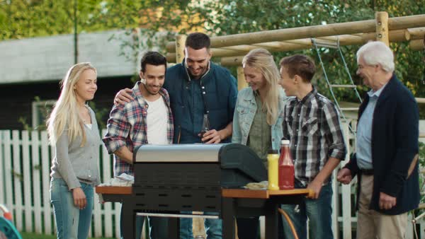 Group of Mixed Race People are Gathering around the Grill on Backyard before Family Dinner. Royalty-free stock video