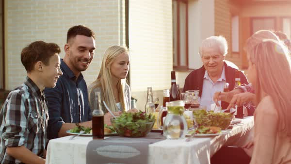 Group of Mixed Race People Having fun, Communicating and Eating at Outdoor Family Dinner Royalty-free stock video
