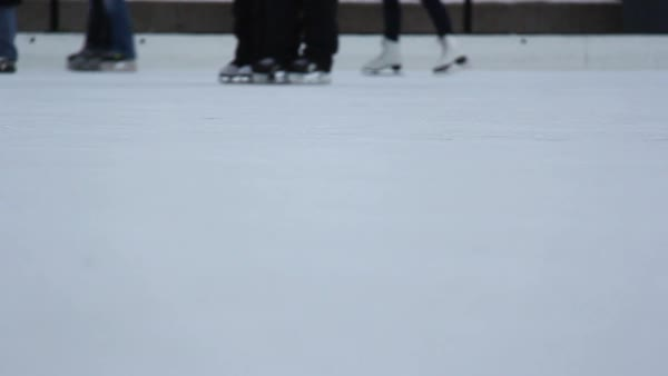 Low angle shot of people ice skating at Olympic Plaza, Calgary Royalty-free stock video