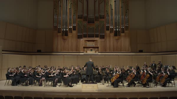 Wide shot of high school orchestra performing on stage Rights-managed stock video