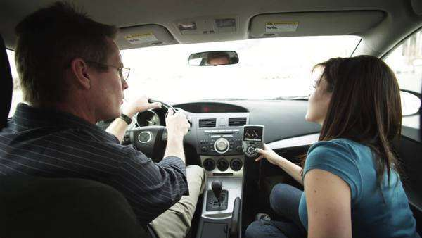 Medium shot of father and daughter using GPS in car Royalty-free stock video