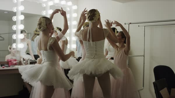 13abae9efc Medium panning shot of ballerinas practicing in dressing room - Stock Video  Footage - Dissolve