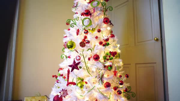 Tilt-up shot of an artificial white Christmas tree Royalty-free stock video