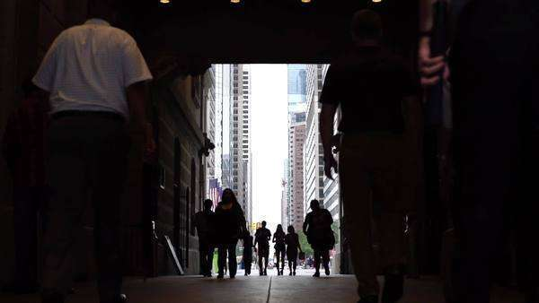 Pedestrians walking through passageway taking shelter from rain in Philadelphia Rights-managed stock video