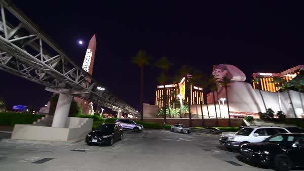 LAS VEGAS, NV - JUNE 30, 2018: Night city view from Luxor Casino Parking   Las Vegas is the world gambling capital  stock footage