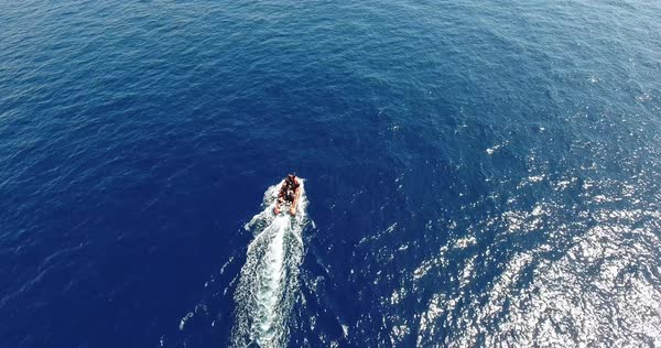Aerial of motorboat goes across blue sea surface Royalty-free stock video