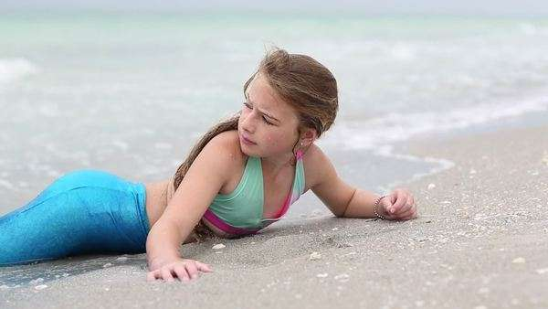 9 Year Old Girl Wearing A Mermaid Costume At The Beach Longboat Key