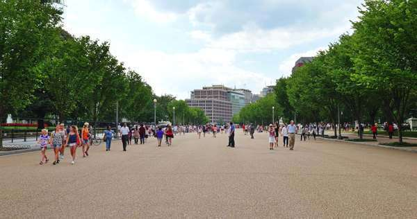 WASHINGTON, D.C. - July, 2015 - Tourists and visitors mill about on Pennsylvania Avenue in front of the White House in Washington, D.C. Royalty-free stock video