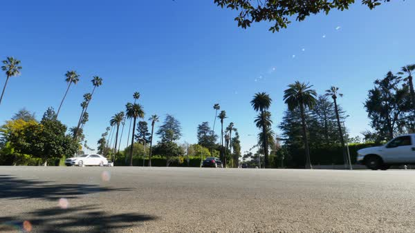 A low-angle view of a typical intersection in the upscale Beverly Hills area of Los Angeles.  	 Royalty-free stock video
