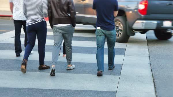 People walking in a crosswalk on Rodeo Drive in Beverly Hills.  	 Royalty-free stock video