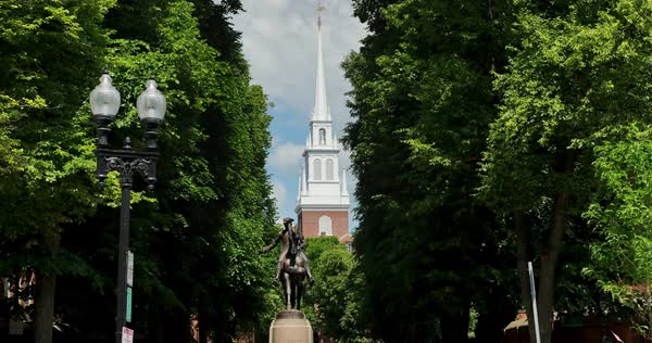 An establishing shot of the Paul Revere Statue near the Old North Church on the Freedom Trail in Boston. Royalty-free stock video