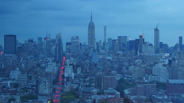 Day to night timelapse over midtown Manhattan while a thunderstorm rolls in over the Empire State Building. Royalty-free stock video