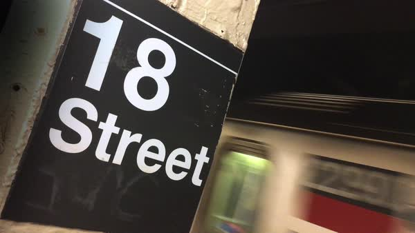 A Manhattan subway car approaches the 18th street station  	 Royalty-free stock video